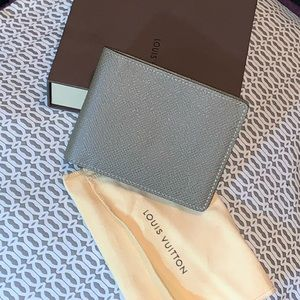 New With Tags Authentic LV Taiga Leather wallet.